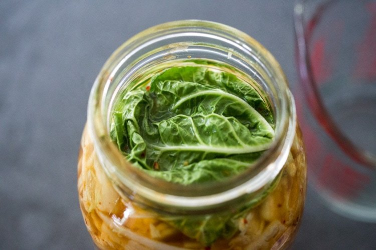 How to make Kimchi that only takes 30 minutes of hands-on-time before mother nature takes over! Full of healthy, gut-healing probiotics, this authentic kimchi recipe is vegan adaptable & gluten free. Quick and easy, make it as spicy or mild as you like. #kimchi #howtomakekimchi #vegan #vegankimchi #eatclean #cleaneating #plantbased #napa cabbage #kimchirecipe #probiotics #fermented #guthealing #fermentedcabbage #koreanfood #koreanrecipe