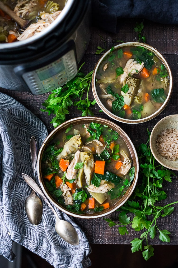 Instant Pot Chicken Artichoke Soup with Wild Rice - a light, healthy and brothy soup with vegetables, wild rice and artichoke hearts with only 15 minutes of hands on time! A quick and easy dinner recipe! Keto friendly! #chickensoup #chickenwildricesoup #instantpotrecipe #instantpotsouprecipe #brothbasedsoup #artichokesoup #easysoup #easydinner #ketosoup
