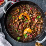 A delicious recipe for Fesenjan, a Persian Walnut Pomegranate Stew with chicken and chickpeas. Earthy, rich and tangy, this is bursting with Middle Eastern Flavor! #persianstew #fesenjan #persianrecipes #persiancchicken #middleeastern #chicken #chickpeastew