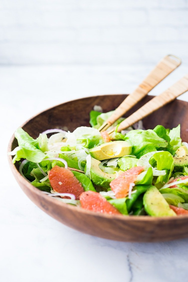 Grapefruit Fennel and Avocado Salad with Pistachios and a Citrus Shallot Dressing. A simple easy salad that is healthy, vegan and delicious! #grapefruitsalad #vegansalad #fennelsalad #avocadosalad #eatingclean #healthysalads