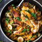 Instant Pot Arroz con Pollo - made in a fraction of the time! This Spanish version is infused with saffron and smoked paprika and full of amazing flavor! #instantpotchicken #instantpotrecipes #spanishchicken #easydinners #ArrozconPollo