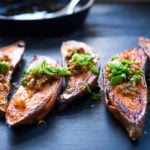 Kyoto Roasted Sweet Potatoes with Miso, Ginger and Scallions - an easy vegan side that is healthy and full of amazing flavor! #sweetpotatoes #yams #veganside #miso#roastedsweetpotatoes #vegan #cleaneating #plantbased #veganside