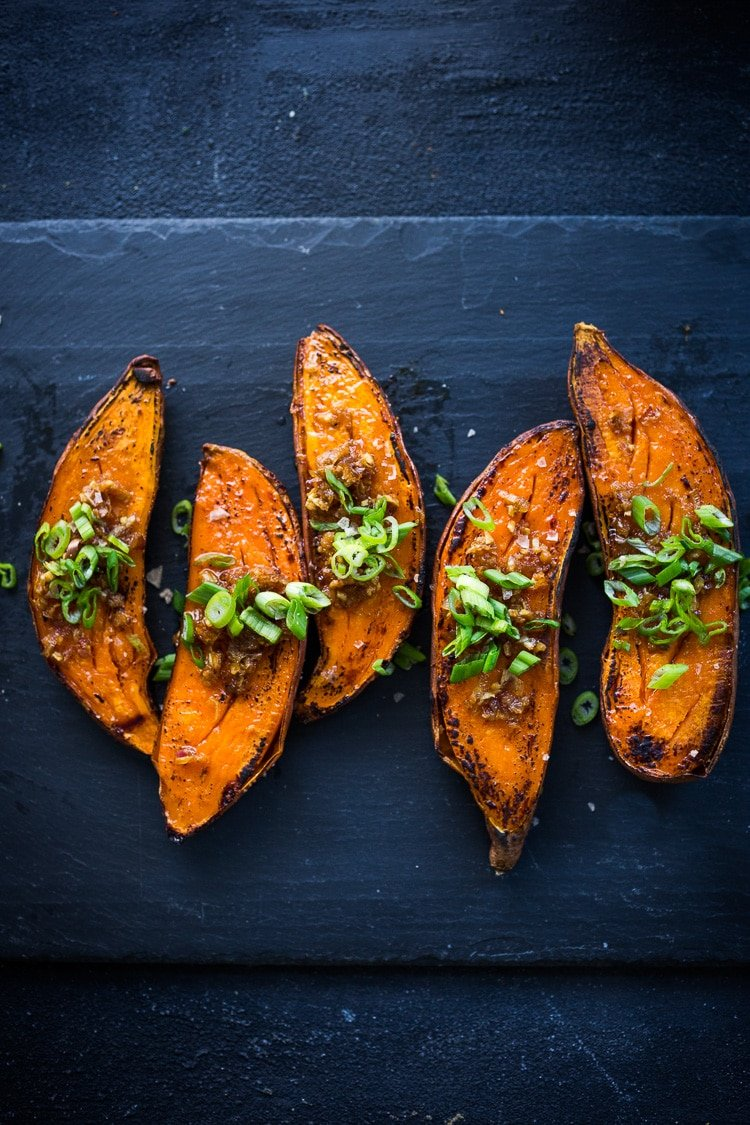 20 Vegetarian Dinner Recipes for FALL! Kyoto Roasted Sweet Potatoes with Miso, Ginger and Scallions - an easy vegan side that is healthy and full of amazing flavor! #sweetpotatoes #yams #veganside #miso#roastedsweetpotatoes #vegan #cleaneating #plantbased #veganside
