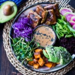 Bali Bowl with Peanut Tofu, black rice, roasted sweet potatoes, shredded cabbage, radish and snow peas. #peanutsauce #peanuttofu #healthybowl #veganbowls #buddhabowls #vegan #plantbased #cleaneating #eatclean #detoxrecipes #balifood #balinese