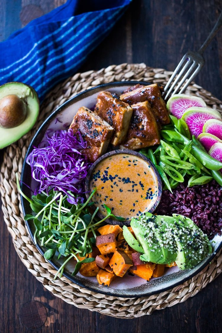 40 Mouthwatering Vegan Dinner Recipes!| Bali Bowl with Peanut Tofu, black rice, roasted sweet potatoes, shredded cabbage, radish and snow peas. #peanutsauce #peanuttofu #healthybowl #veganbowls #buddhabowls #vegan #plantbased #cleaneating #eatclean #detoxrecipes #balifood #balinese