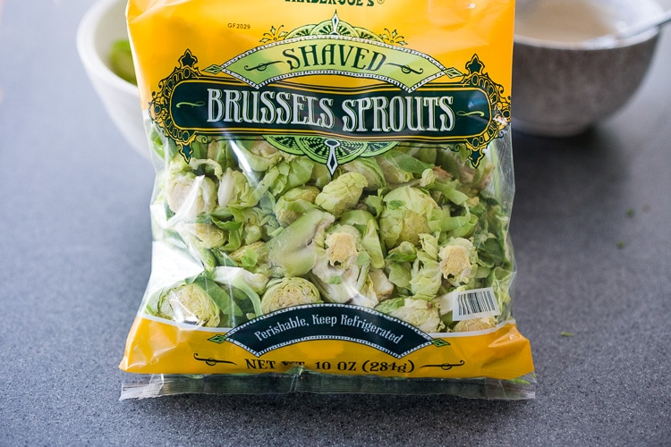 Lemony Brussel Sprout Salad with Creamy Tahini Sauce and Pistachios - a tasty, vegan salad that can be made ahead. Perfect for midweek lunches or potlucks or gatherings. #brusselsprouts #brusselsproutsalad #brusselsproutslaw #brusselsproutsrecipes #vegan #plantbased #cleaneating #eatclean #vegansalad