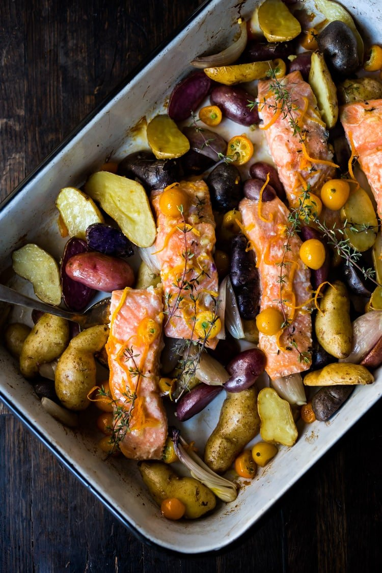 Citrus Baked Salmon with roasted fingerlings and kumquats in a flavorful citrus marinade. With only 15 minutes of hands on time, this simple easy diner recipe is perfect for busy weeknights! #salmonbake #roastedsalmon #healthysalmon #bakedsalmon #weeknightdinner #kumquats #fingerlings #citrus #citrussalmon