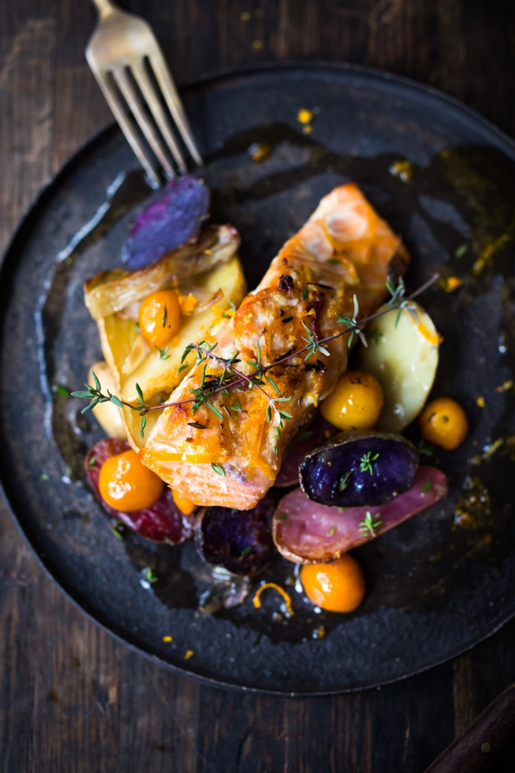 Citrus Baked Salmon with roasted fingerlings and kumquats in a flavorful citrus marinade. With only 15 minutes of hands on time, this simple easy diner recipe is perfect for busy weeknights! #salmonbake #roastedsalmon #healthysalmon #bakedsalmon #weeknightdinner #kumquats #fingerlings #citrus #citrussalmon #sheetpandinner