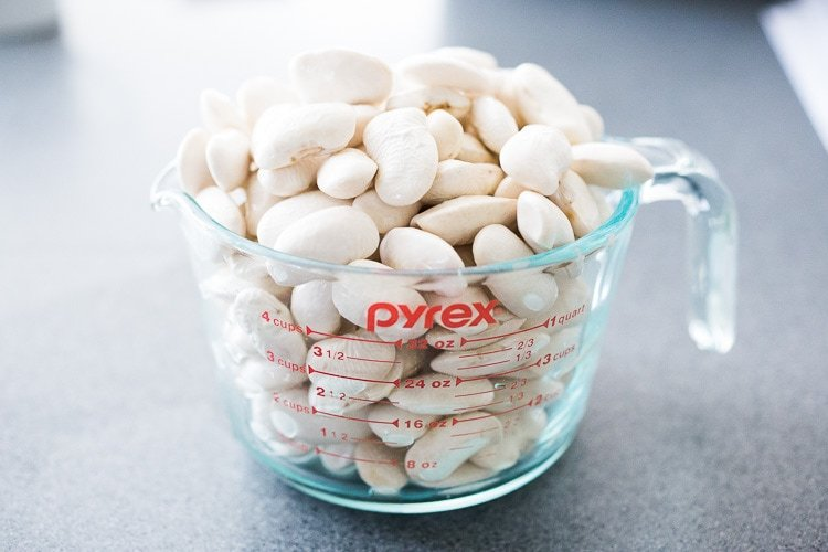 Corona Beans- giant buttery white beans seasoned with olive oil, garlic, fresh herbs and lemon zest. Serve as a vegan main or side dish or add to salads and Buddha Bowls. #corona #beans #whitebeans #Gigantes #royalcoronabeans