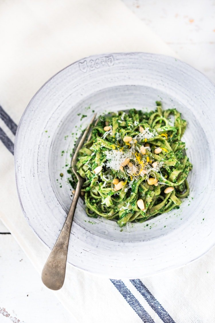 Spring Nettle Pesto Pasta with toasted pine nuts and lemon zest. Full of nutrients and so delicious! #nettles #nettlerecipes #nettlepesto | www.feastingathome.com