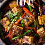 Szechuan Tofu and Veggie Stir Fry! A flavorful vegan stir-fry with crispy tofu, szechuan sauce and loaded up with healthy vegetables! Quick, easy and flavorful!!! #vegan #szechuan #szechwan #szechuansauce #tofu #stirfry #stir-fry