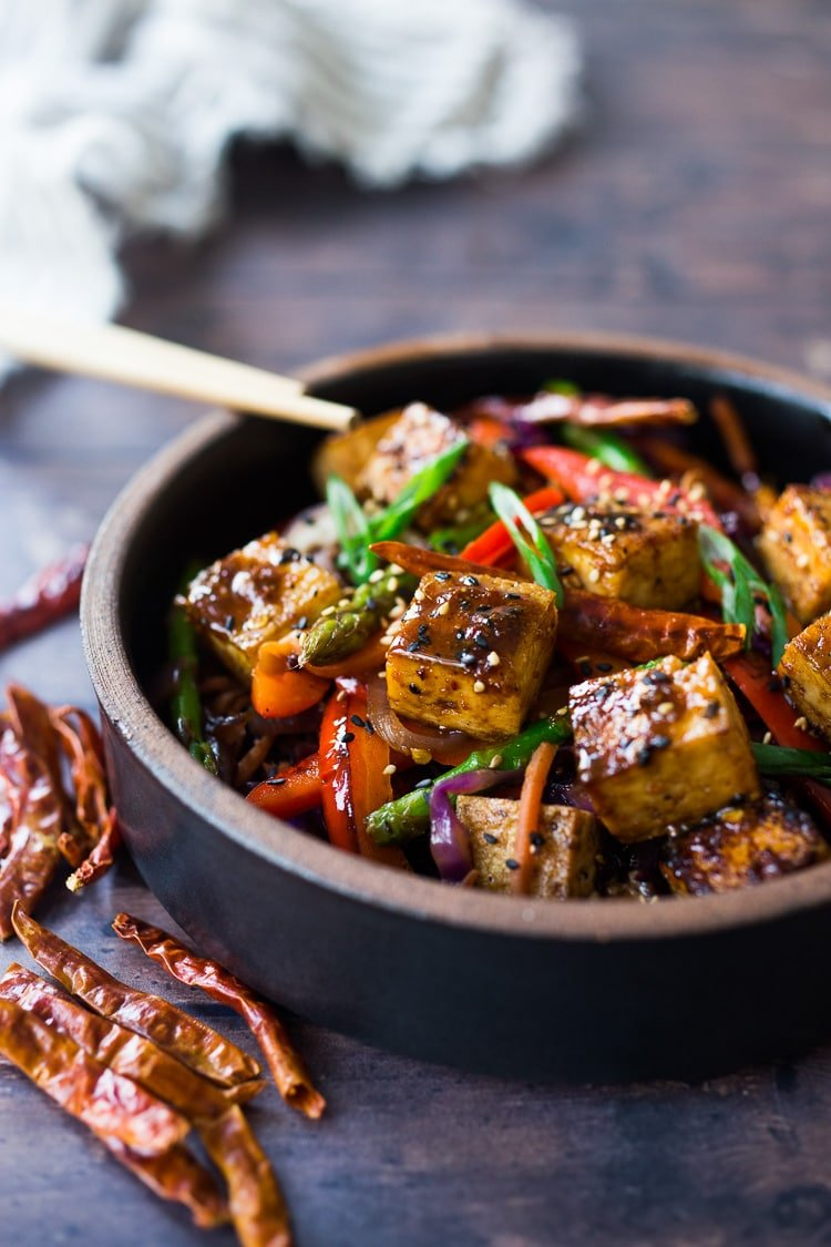 Szechuan Tofu and Veggies! A flavorful vegan stir-fry with crispy tofu, szechuan sauce and loaded up with healthy vegetables! Quick, easy and flavorful!!! #vegan #szechuan #szechwan #szechuansauce #tofu #stirfry #stir-fry