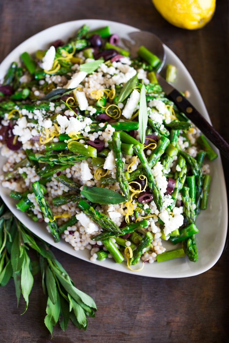 Spring Asparagus Salad with Israeli Cous Cous ( or use a grain!) kalamata olives, feta, lemon zest and mint with a lemony dressing. #asparagus #asparagussalad