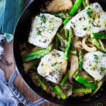 Baked Cod with Asparagus, Fennel and Leeks - a simple, spring-inspired dinner! #bakedcod #cod #codrecipes #recipes #fish #bakedfish #springrecipes #ketorecipes #lowcarb