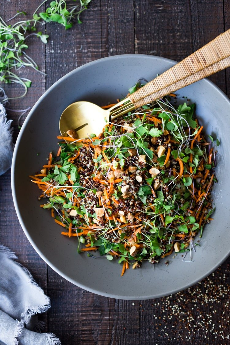 Carrot Quinoa Salad with Almonds and Raw Apple Cider Vinaigrette- a delicious vegan salad that can be made ahead. #vegan #quinoa #quinoasalad #carrotsalad #vegansalad