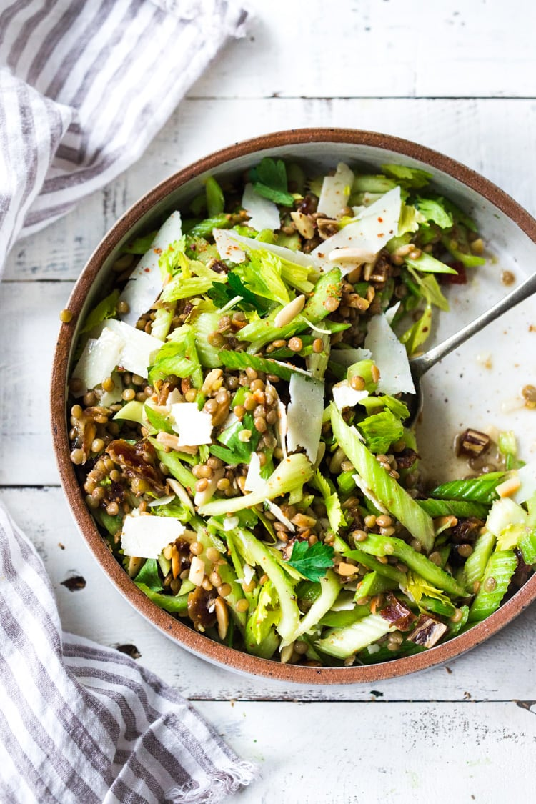 25 Tasty Lentil Recipes - that are not bland or boring! | Celery Salad with lentils, dates and almonds - a delicious make ahead salad that keeps for several days in the fridge. Keep it vegan or add shaved pecorino! #celerysalad #lentilsalad #healthysalad #salad #vegansalad