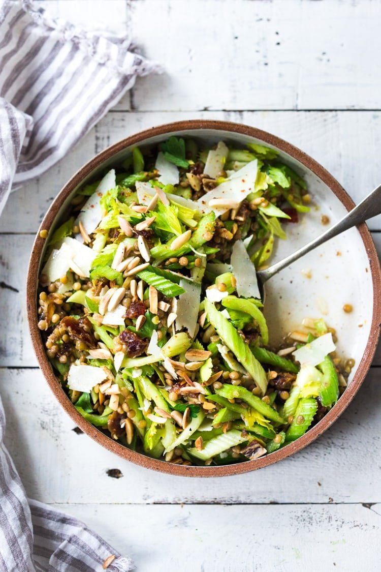 Celery Salad with lentils, dates and almonds - a delicious make ahead salad that keeps for several days in the fridge. Keep it vegan or add shaved pecorino! #celerysalad #lentilsalad #healthysalad #salad #vegansalad
