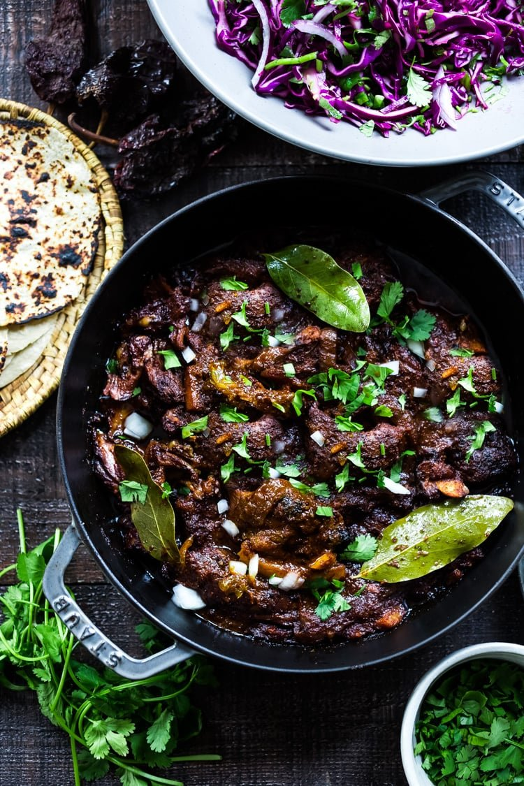 Mexican Lamb Barbacoa - a simple delicious recipe from Oaxaca that results in tender, juicy falling off the bone lamb perfect for tacos and burritos! #tacos #barbacoa #lamb #lambrecipes #oaxaca #mexicanrecipes #cincodemayo