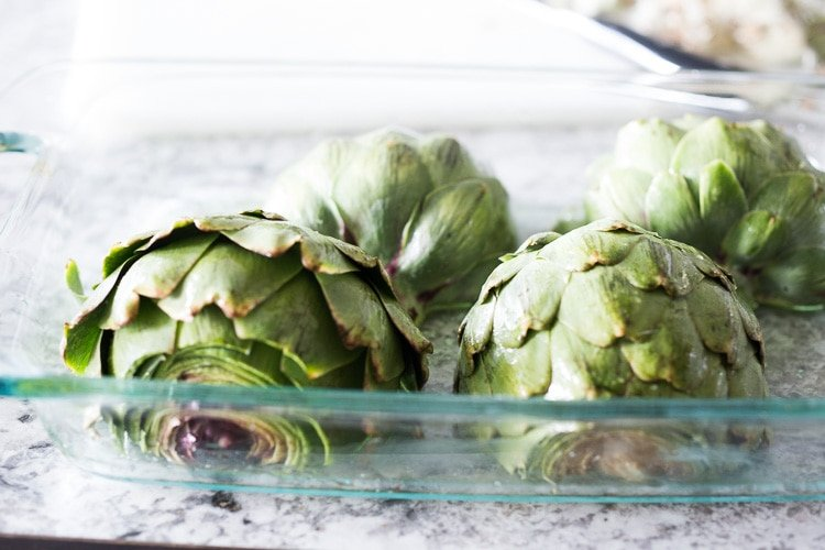 How to roast Artichokes! Roasted Artichokes with Lemony Leek dressing - a healthy vegan way to cook and serve our favorite spring vegetable! #artichoke #artichokes #bakedartichokes #roastedartichokes #vegan #veganartichokesauce