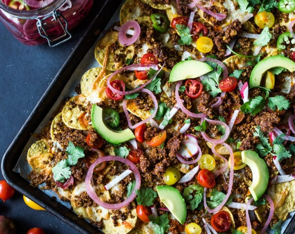 """Nachos Supreme! These loaded vegetarian nachos are made with flavorful """"walnut chorizo""""! A healthy, delicious nacho recipe that is baked in the oven. Vegan-adaptable and Gluten free! #nachos #vegannachos #vegetarian"""