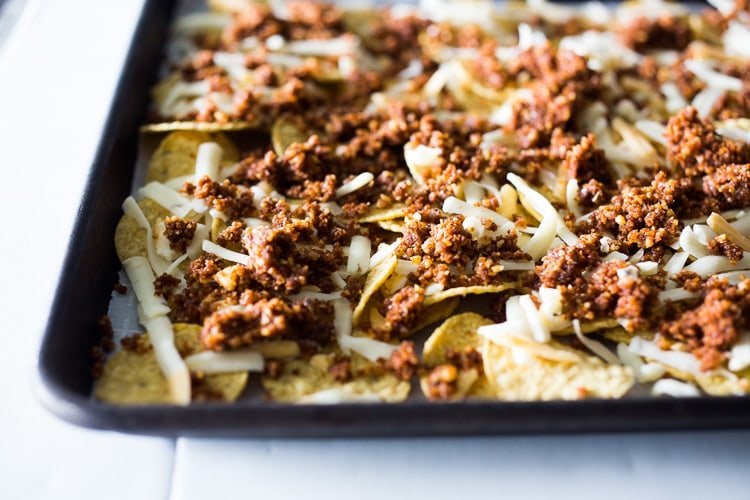 "Nachos Supreme! These loaded vegetarian nachos are made with flavorful ""walnut chorizo""! A healthy, delicious nacho recipe that is baked in the oven. Vegan-adaptable and Gluten free! #nachos #vegannachos #vegetarian"