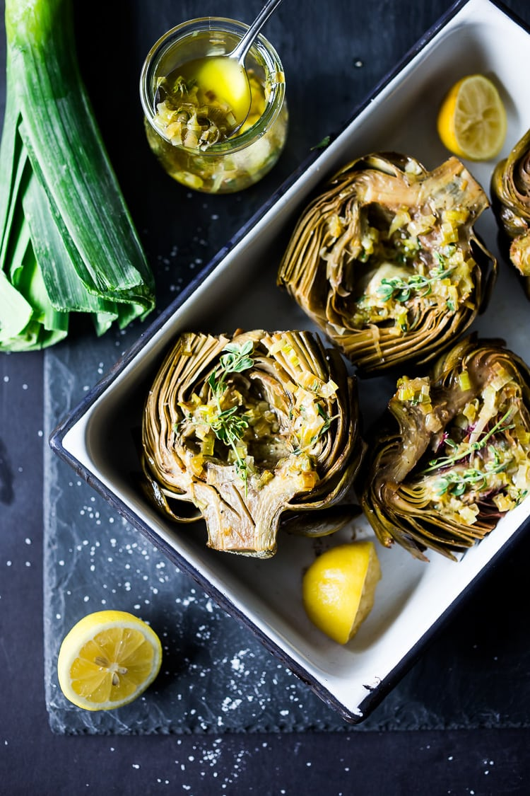 Roasted Artichokes with Lemony Leek dressing - a healthy vegan way to cook and serve our favorite spring vegetable! #artichoke #artichokes #bakedartichokes #roastedartichokes #vegan #veganartichokesauce