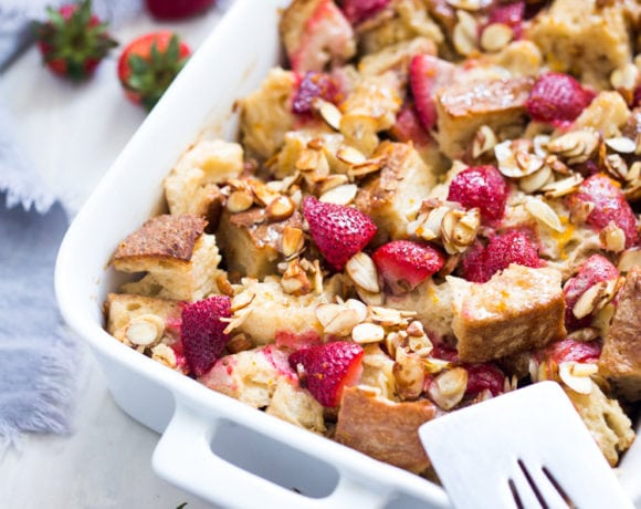Baked French Toast (Vegan) with fresh berries orange zest and almonds. A healthy version of our favorite brunch recipe! Can be made ahead! #brunch #mothersday #veganbrunch #vegan #frenchtoast #feastingathome #healthybreakfast