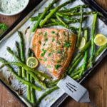 Roasted Salmon with Asparagus and Dill Sauce and simple sheet-pan dinner that comes together in 30 minutes. #salmon #roastedsalmon #bakedsalmon #aspargus #dinner #sheetpandinner #easyrecipes