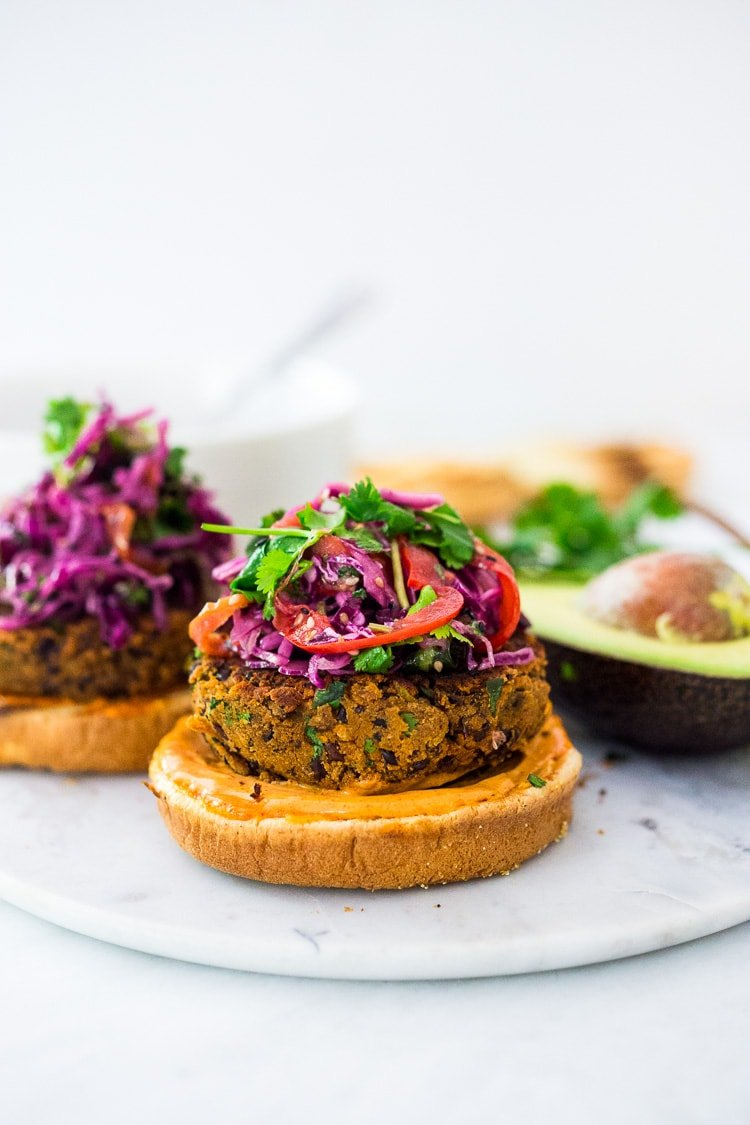A quick and easy recipe for Smoky Chipotle Black Bean Burgers that can be made in under 30 minutes! Vegan adaptable and perfect for weekly meal prep! #blackbeanburger #veggieburger #veganburger #burger
