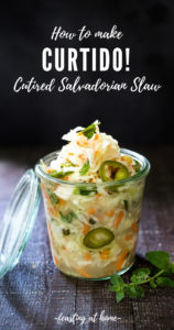 How to make Curtido - A cultured Salvadorian Slaw with cabbage, carrots, onion and oregano. Simple to make, full of healthy probiotics! Use on Tacos, Pupusas, quesadillas or enchiladas as a delicious healthy condiment! #Curtido #fermented #slaw #cultured #kraut