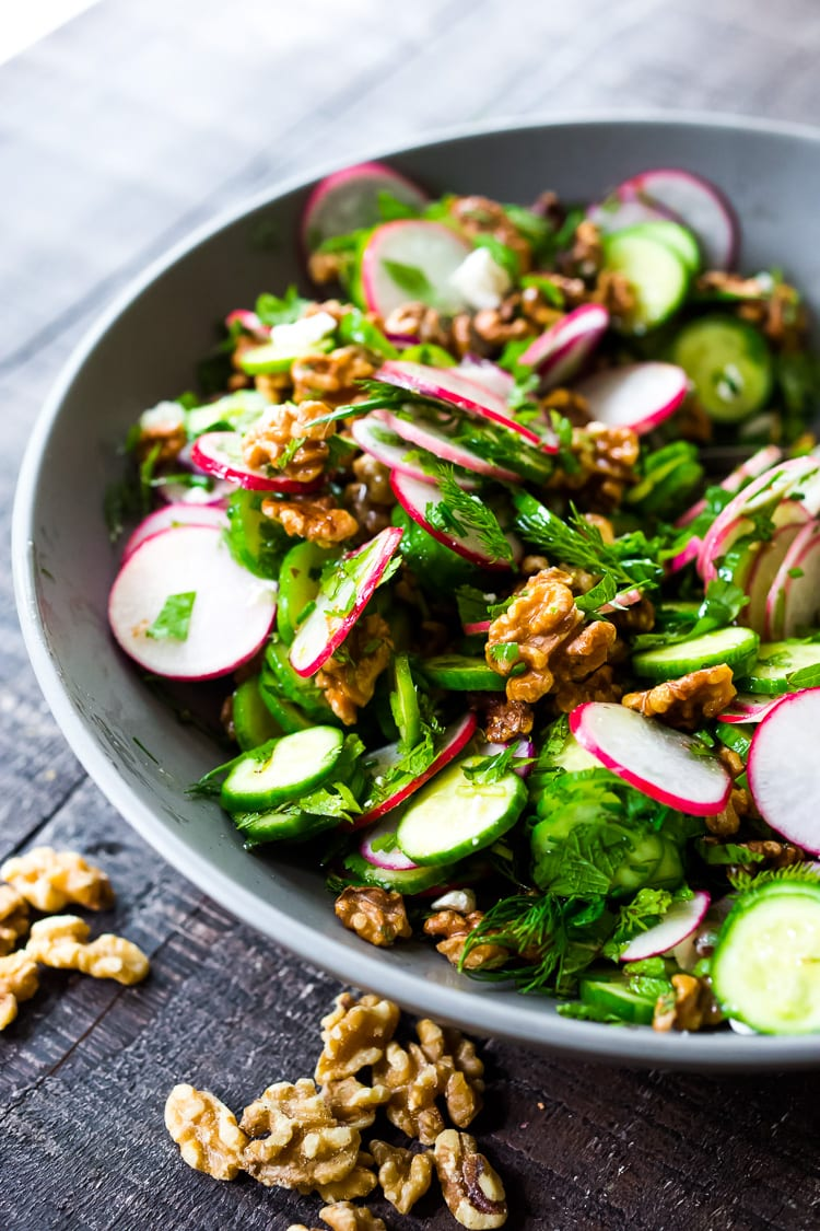 Persian Walnut Salad with Cucumbers, Radishes, Mint, Dill, Cilantro and Parsley. Loaded up with fresh herbs this refreshing summer salad is the perfect side to summer grilling! #walnuts #cawalnuts #walnutsalad #persiansalad #herbsalad #persianherbsalad