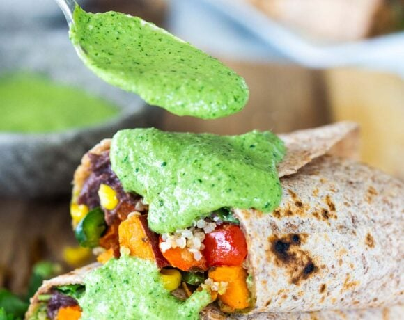 These Peruvian Burritos are filled with roasted sweet potato, fresh corn, peppers, quinoa and creamy blackbeans, then drizzled with spicy Peruvian Green Sauce. A flavor bomb! Vegan and Delicious! #vegan #burrito #peruvianfood #peruvianrecipes #veganburrito