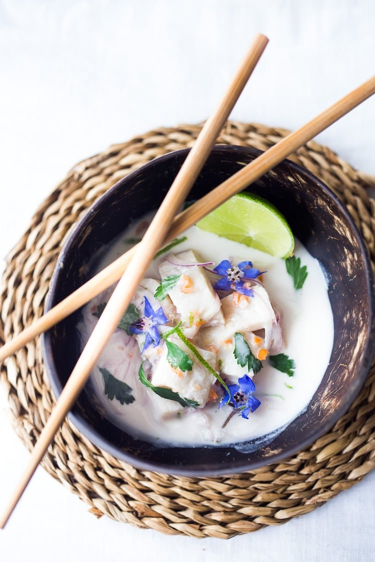 A simple delicious recipe for Peruvian Ceviche made with fish, chilies, lime, a splash of coconut milk and a hint of ginger. Easy, healthy flavorful! #ceviche #peruvianceviche #lechedetigre