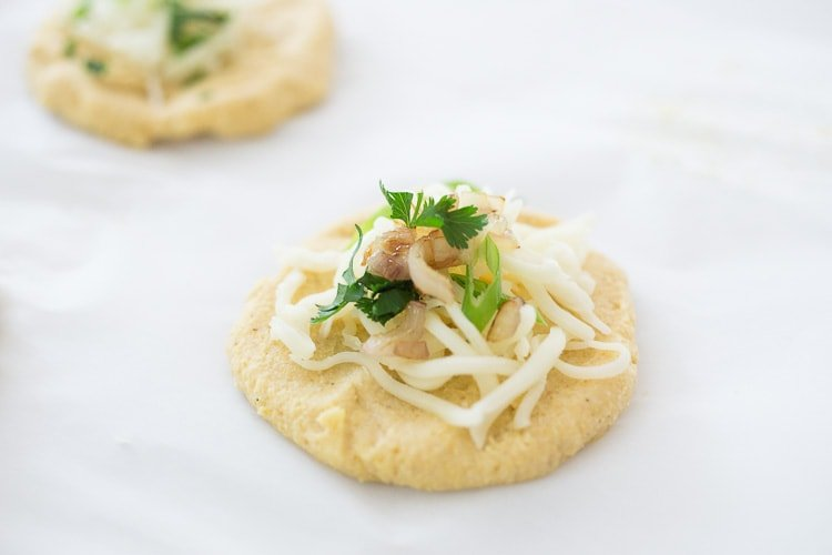 How to make Pupusas!  Delicious Salvadorian masa corn cakes filled with your choice of refried beans or cheese (or both!) with cilantro and scallions. A simple, easy recipe that is Vegan adaptable! #pupusa #pupusas #pupusarecipe #curtido #corncakes #masa #masacakes