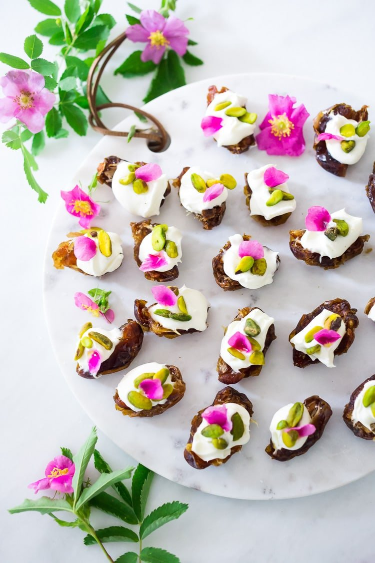 Stuffed Dates with Wild Rose Petals and Pistachios- a simple decadent appetizer or light dessert. #stuffeddates #dates #rosepetals #daterecipes #wildroses #rose #recipes
