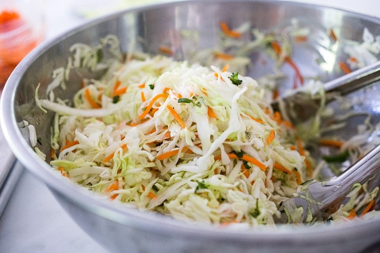 Curtido - A cultured Salvadorian Slaw with cabbage, carrots, onion and oregano. Simple to make, full of healthy probiotics! Use on Tacos, Pupusas, quesadillas or enchiladas as a delicious healthy condiment! #Curtido #fermented #slaw #cultured #kraut