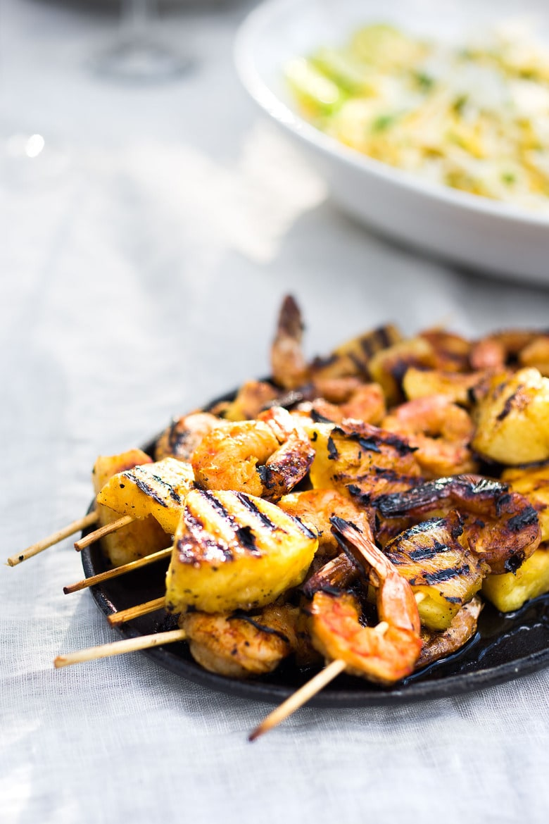 Grilled Shrimp Skewers with Pineapple in a flavorful Chipotle Marinade served with a refreshing Jicama Mango Slaw with cilantro and lime. Healthy and Easy! #grilledshrimp #shrimpskewers #shrimpkabobs #skewers www.feastingathome.com