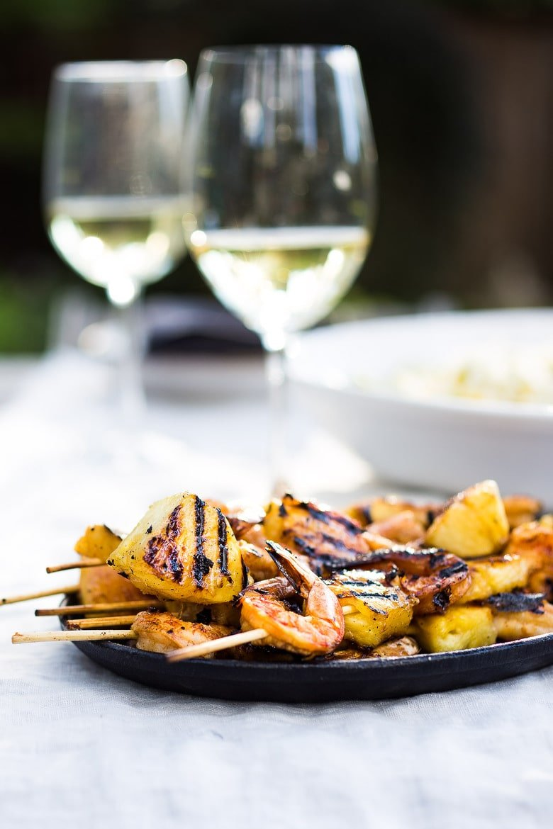 Pineapple Shrimp Skewerswith the most flavorful chipotle marinade. Sweet, tangy, smoky with a little spice- a delicious combination of flavors! Served over a refreshingJicama Mango Slaw!