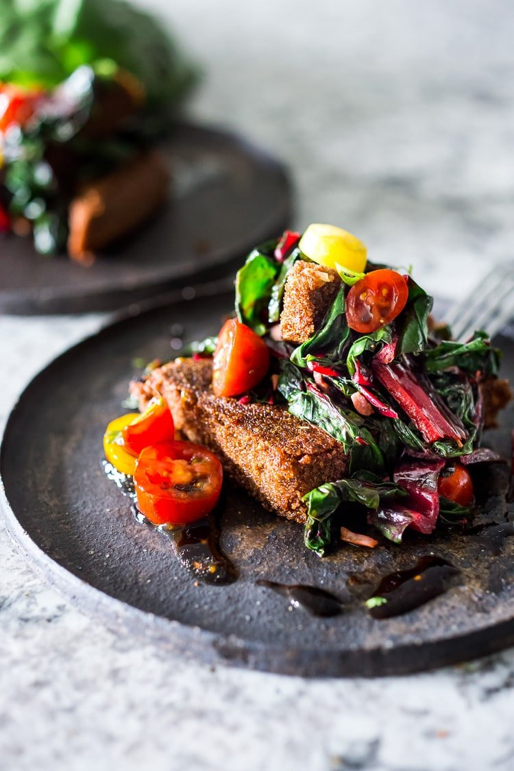 Crispy Teff Cakes with Wilted Chard and fresh Tomato Relish - a simple delicious vegan meal that is full of protein and nutrients! #teff #teffrecipes #teffcakes