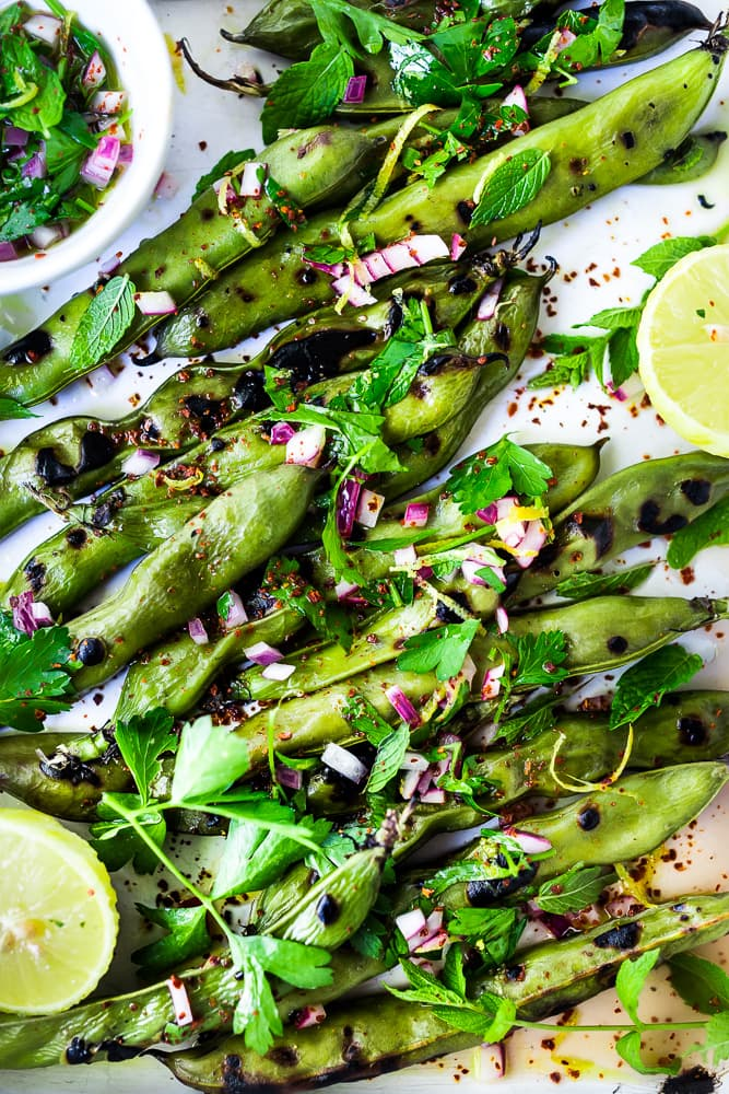 Grilled Fava Beans- with Mint, Lemon & Sumac, a simple, easy way to prepare fresh fava beans on the grill with Middle Eastern flavors. #fava #favabeans #grilled #favabeanrecipes
