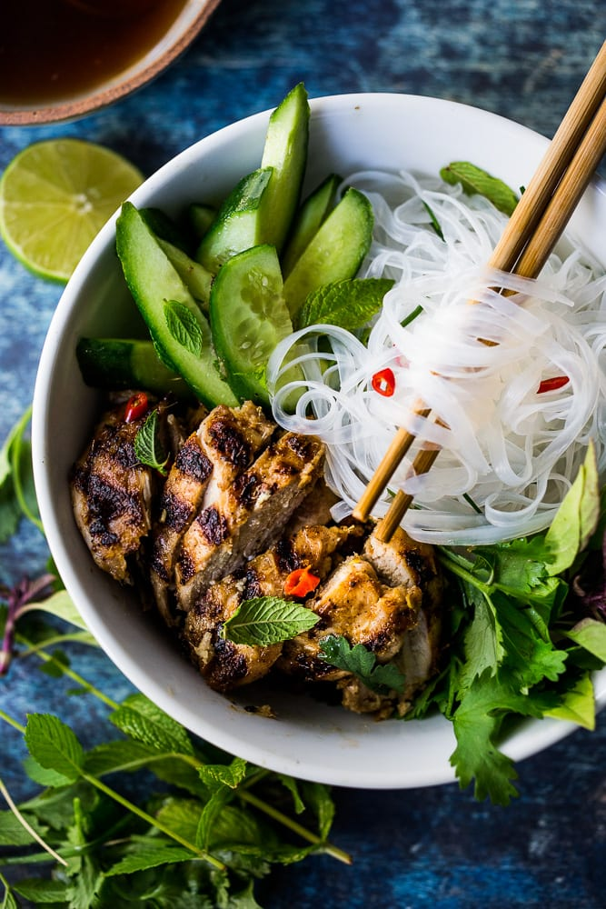 Grilled Lemongrass Chicken- bursting with Vietnamese flavors . Use this in Vietnamese Rice Noodle bowls ( Bun Ga Nuong )or own its own. Amazing flavor! #lemongrasschicken #vietnamesechicken #grilledchicken #lemongrass #lemongrassmarinade #vietnamesenoodlebowl