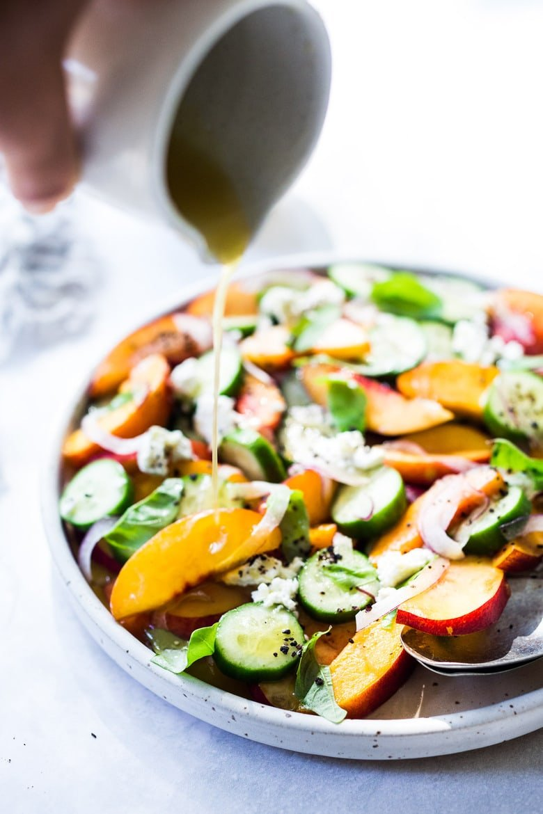 Nectarine Salad with cucumber, Basil, Goats Cheese, Red onion and optional Urfa Biber ( Turkish Chili Pepper). A simple delicious Farmers Market Salad you can put together in minutes! #nectarinesalad #nectarines #nectarinerecipes #farmersmarket #healthysalad #easysalads #cucumbersalad