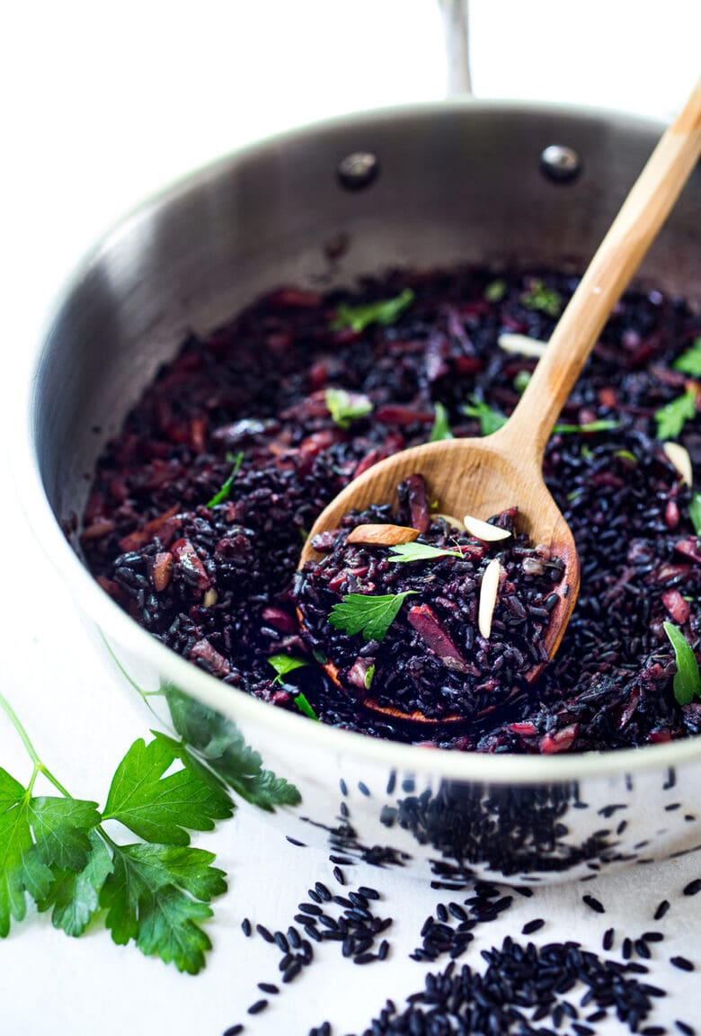 Why we ALL should be eating Forbidden Black Rice! Plus 3 healthy ways to cook black rice- stovetop, Instant Pot & Pilaf! A healthy vegan gluten-free side dish full of powerful health benefits. The most nutritious rice you can find! #blackrice #forbiddenblackrice #howtocookblackrice #vegansides #healthysides #antioxidant #cleaneating #eatclean