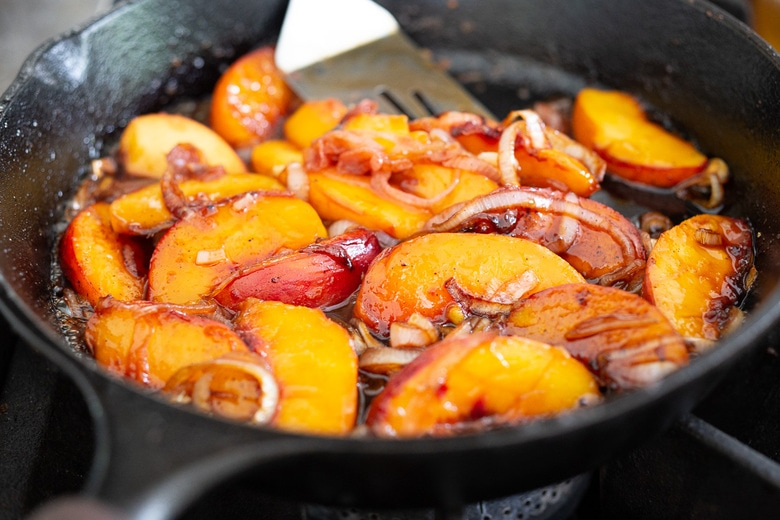 Chili Lime Chicken with Glazed Peaches - a fast and easy weeknight dinner highlighting fresh juicy peaches. Can be made with breast or thigh meat. #chicken #chickenrecipes #peaches #easydinner #chililimechicken #weeknightdinner #easydinner #bakedchicken