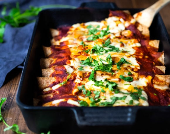 Farmers Market Vegetarian Enchiladas- with black beans and your choice of veggies (like red bell pepper, zucchini and corn)and Homemade 5 Minute Enchilada Sauce! Easy, Healthy and full of delicious Mexican Flavor!Vegan and Gluten-free adaptable! #enchiladas #vegetarianenchiladas #healthyenchiladas #veggieenchiladas
