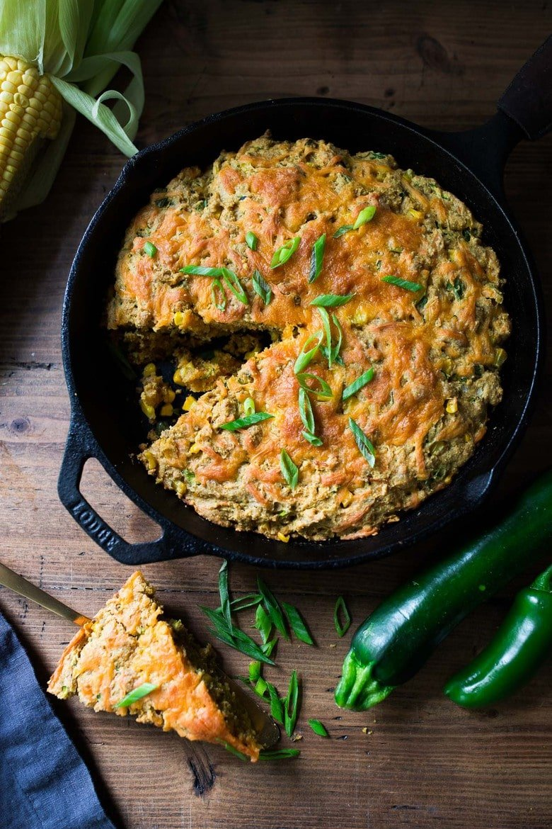 Zucchini Cornbread! A savory zucchini bread infused with Mexican spices, cornmeal, fresh corn and sharp cheddar cheese, baked in a skillet. A cozy side to stew, soup and chili.