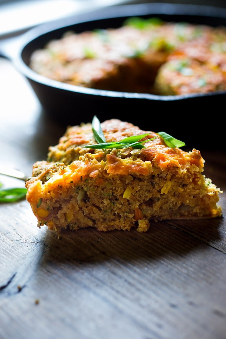 Zucchini Cornbread! A savory zucchini cornbread infused with Mexican spices, cornmeal, fresh corn and sharp cheddar cheese, baked in a skillet. A cozy side to stew, soup and chili.