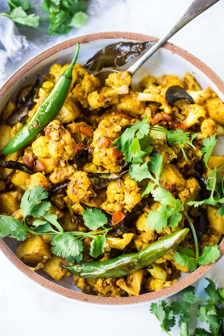 Flavorful Aloo Gobi! Indian-Spiced Potatoes and Cauliflower with Masala Spices- an easy authentic healthy Indian classic that can be made on the stovetop! Vegan adaptable. #aloo #aloogobi #aloogobimasala #indianfood #potatorecipes #cauliflowerrecipes #vegetarian