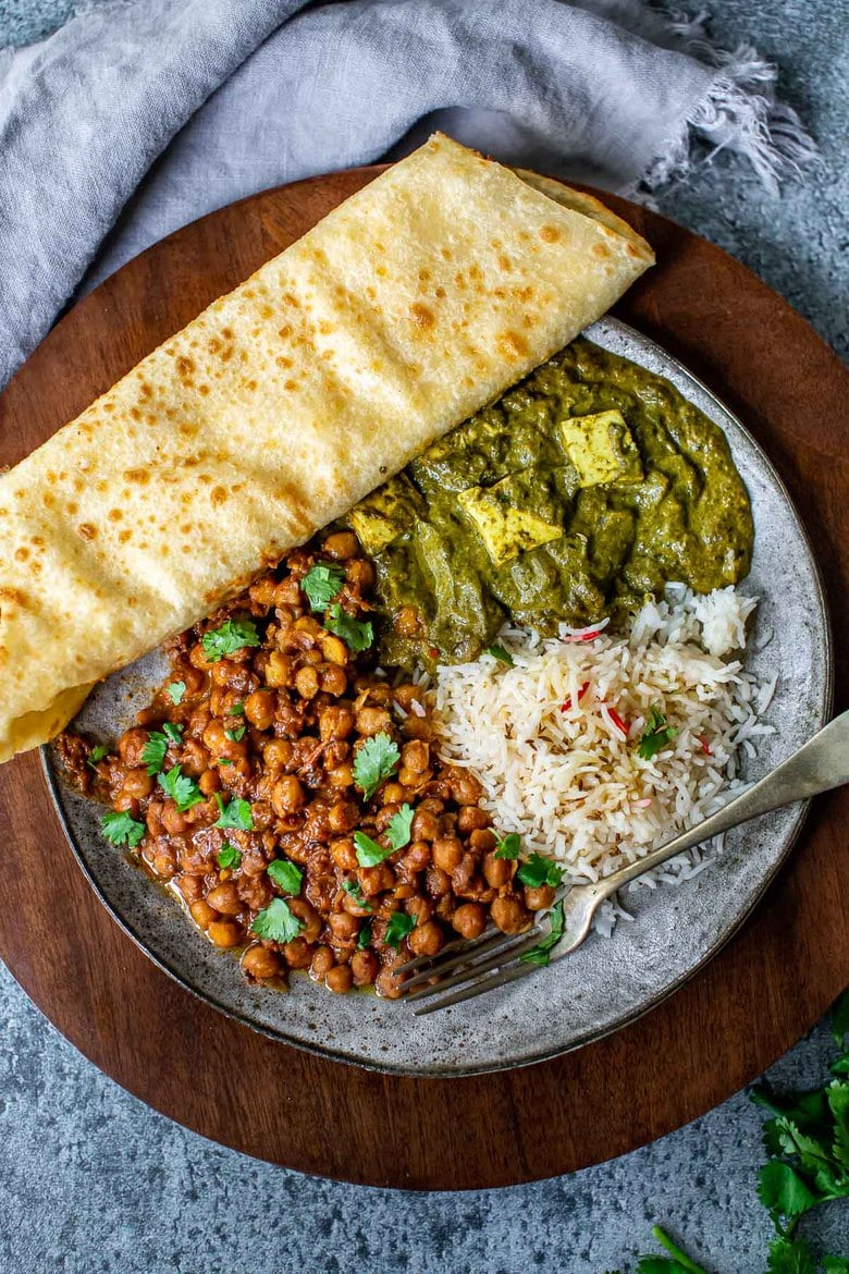 This authentic Chana Masala Recipe can be made in an Instant pot or on the stove top. A quick and easy Vegetarian dinner recipe that is full of amazing Indian flavor! #chanamasala #chana #vegetariandinner