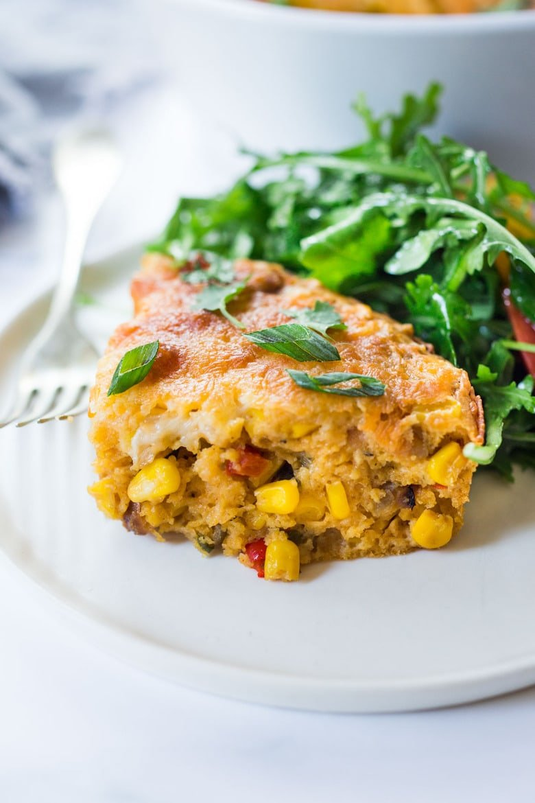 Cornbread Casserole! Seasoned with Mexican spices and filled with healthy veggies and cheddar cheese, this easy corn casserole can be put together in just 20 minutes before baking in the oven. #weeknightdinner #weeknightmeal #vegetariandinner #vegetarian #cornbread #corncasserole #cornbreadcasserole